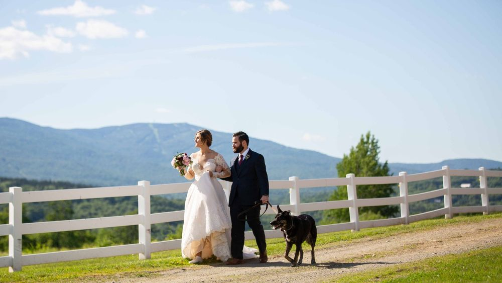 White split rail fence provides intimate photo opportunity for the Bride and Groom (and furry friend;)  (Michelle Frehsee Photography)