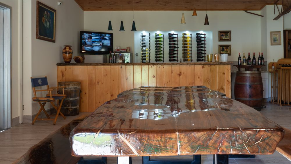 Indoor tasting room with wet bar.