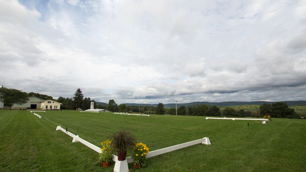 Outdoor riding ring - perfect flat area for tented reception or open air ceremony site.