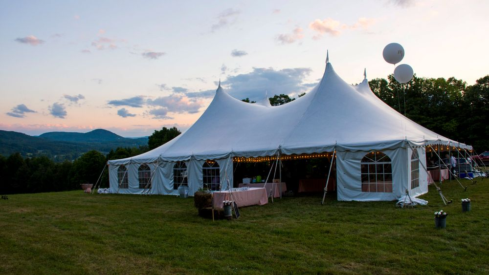 Outdoor tented reception site.