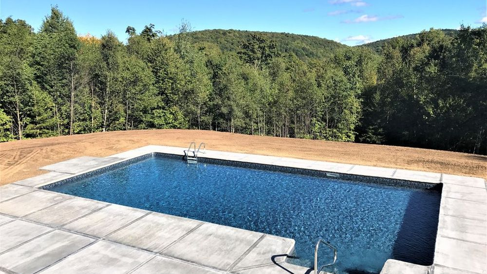 Newly installed pool in front lawn overlooking the mountains.