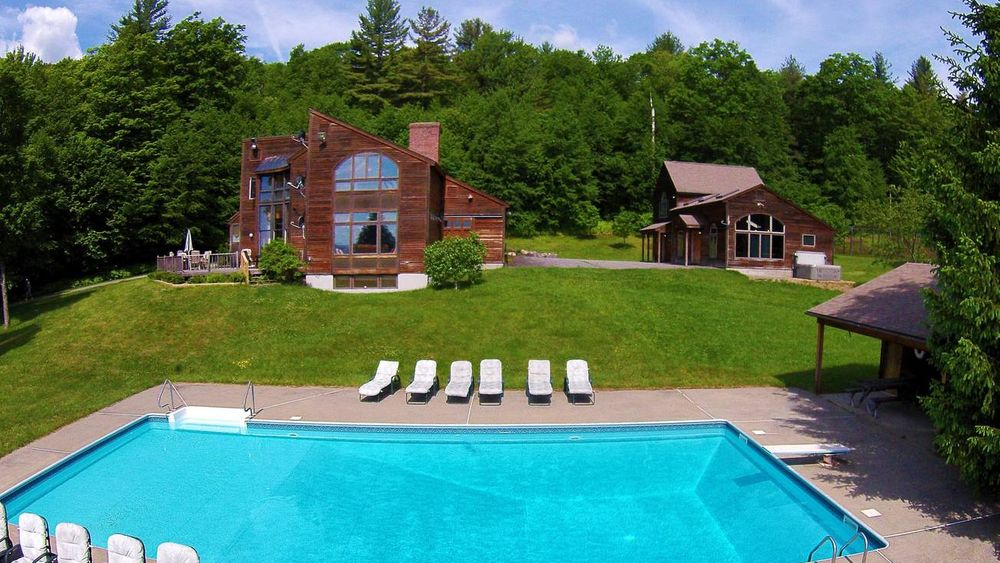 Main estate with in-ground pool and guest/game house.