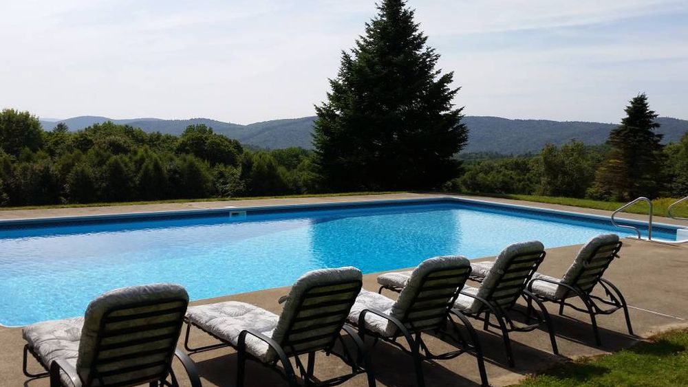 In-ground pool with mountain view.