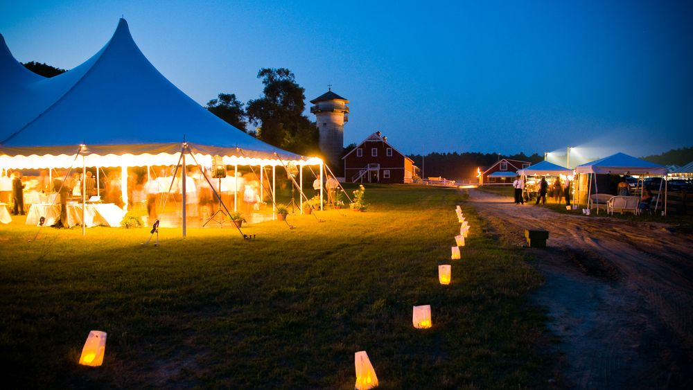 Elegant tented reception with paper lanterns creating a romantic ambiance.