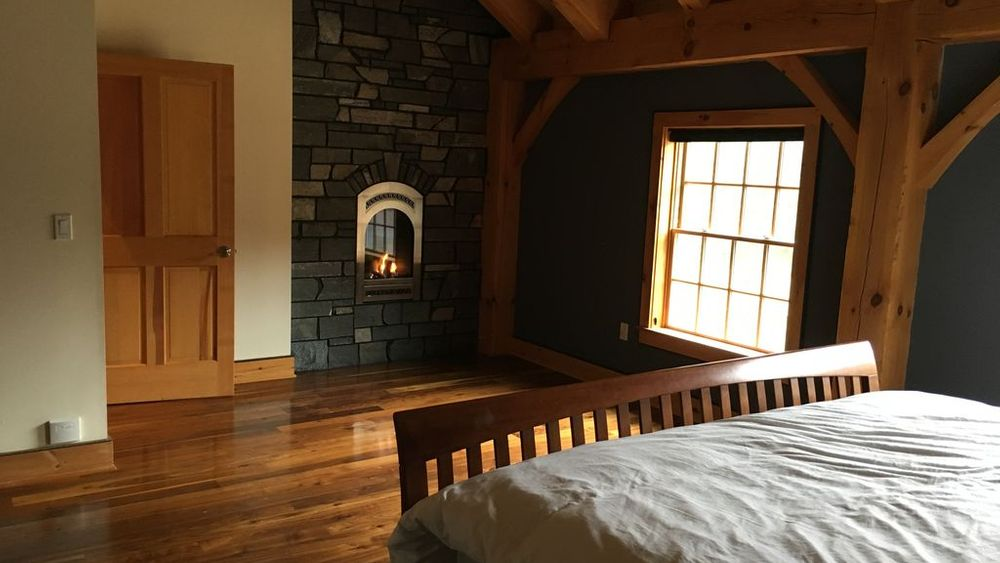 Master suite with fireplace.