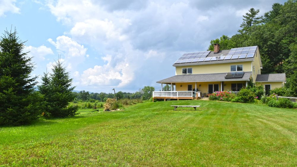 Farmhouse overlooking main lawn for ceremony or smaller receptions.