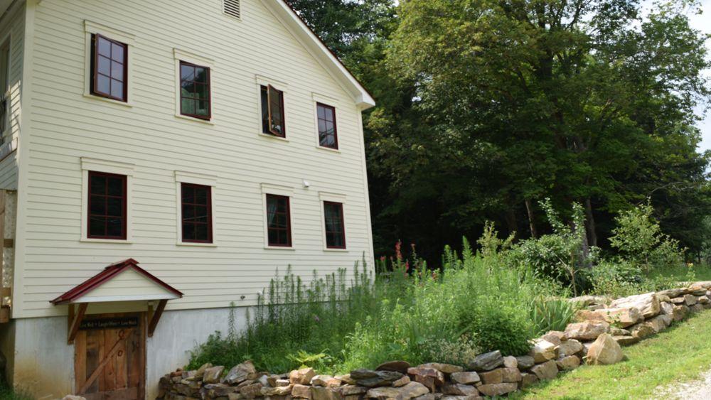 Farmhouse side view with unique stonework