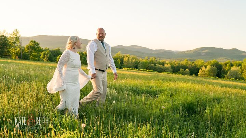 Wedding couple in the open meadow. Photo Credit: Kate and Keith Photography