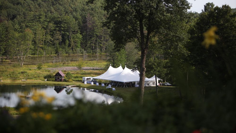 Exclusive tented reception lakeside view.