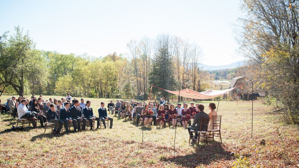 ceremony in field behind the barn
