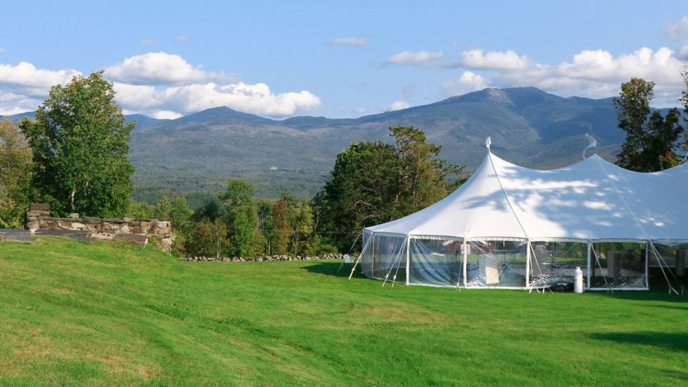 Outdoor tented reception location set across from historic hotel foundation and set against the White Mountains for your a natural backdrop with unparalleled views.