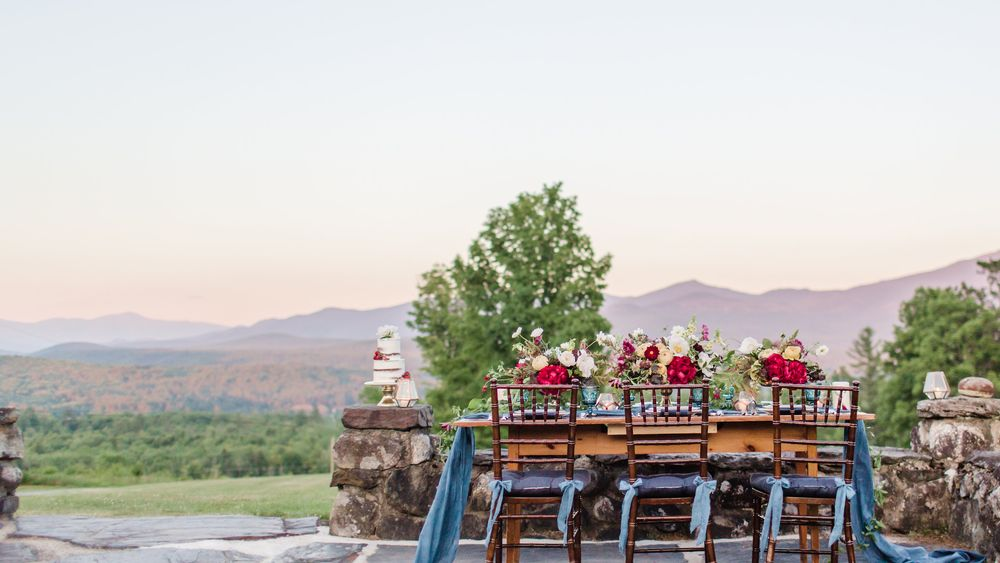 Tables setup on granite patio with sweeping views of the White Mountains.  (Rodeo & Co Photography)