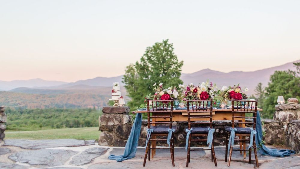 Stone foundation of property's former historic hotel, featuring tablescape set against sweeping views of the White Mountains.  (Rodeo & Co Photography)