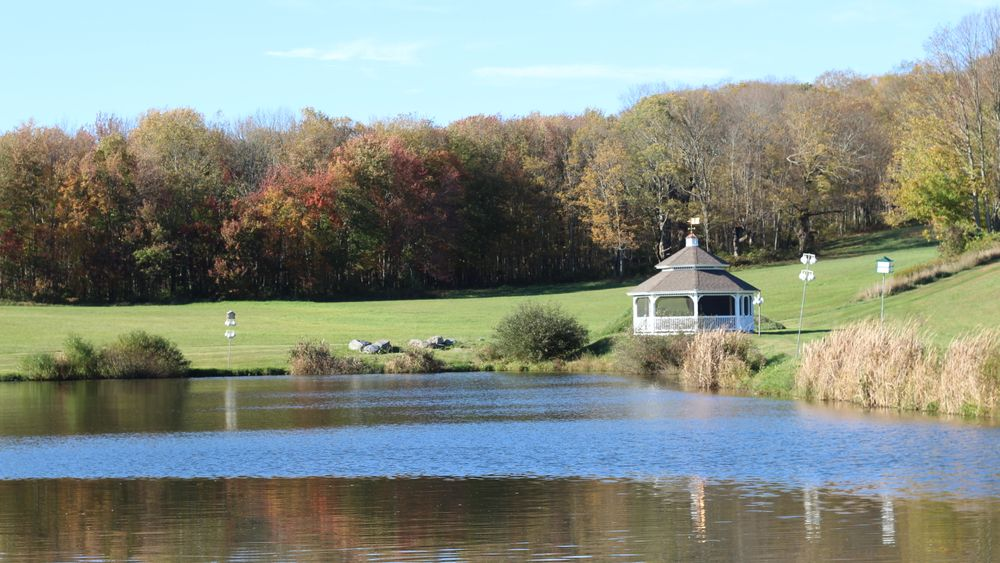 The pond and gazebo provide a beautiful setting for your wedding