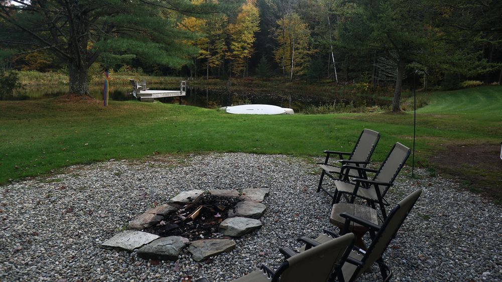 Fire-pit overlooking pond.