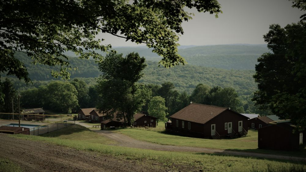 Camp Rock Creek Wedding Venue. (sleeps 144 guests in shared bunk cabins and select individual rooms).