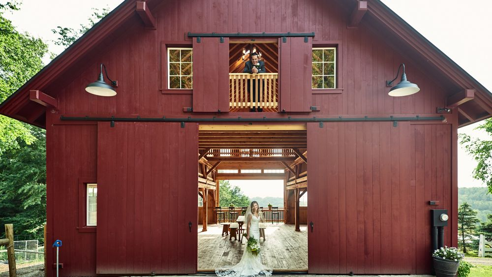 Cate Bligh- THE GREEN BARN WEDDING PHOTOGRAPHY- View from behind barn, looking through it as guests would enter