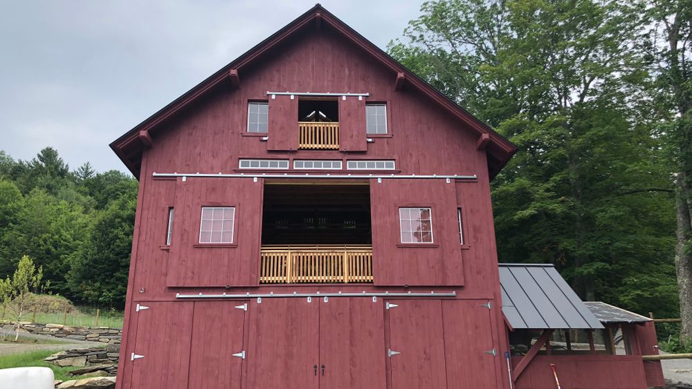 Full view of barn with two upper levels as event space with mountain views.