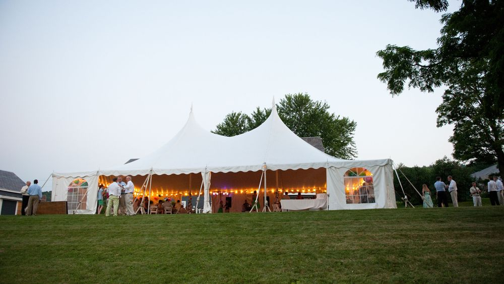 View of the tented wedding reception. Photo Credit: Kat Mooney Photography