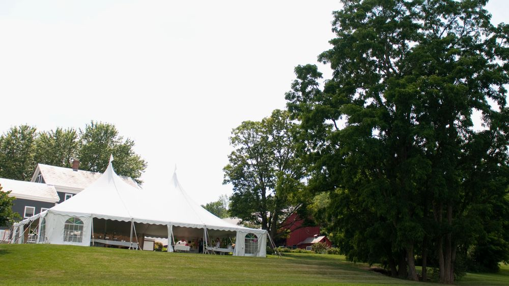 Back view of the reception tent. Photo Credit: Kat Mooney Photography